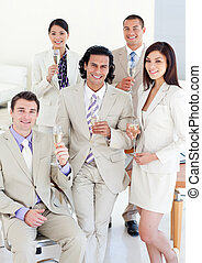 Successful business team standing in a office in a meeting