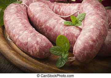 sausage - raw homemade sausage on a wooden board