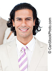 Attractive businessman standing against a white background