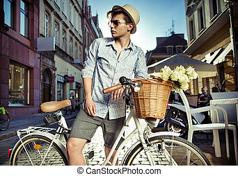 Elegant man on the retro bicycle