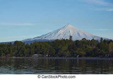 Lakes and Volcanos of Chile - Snow capped cone of Villarrica...