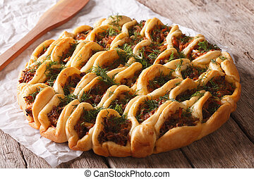 Open pie with ground meat and vegetables. horizontal - Open...