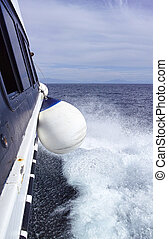 white fender - detail of a white fender of a ferry in...