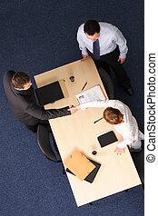 formal handshake - female business employee shaking the hand...