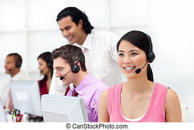 Concentrated business people with headset on working in a...