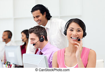 Multi-ethnic business people working in a call center
