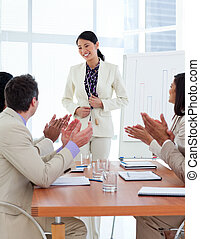 Smiling Asian businesswoman doing a presentation