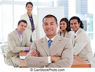 Assertive businessman in a meeting with his team