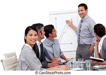 Positive manager giving a presentation against a white...