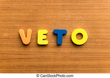 veto  colorful word on the wooden background