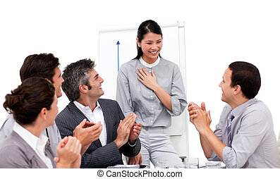 Victorious businesswoman applauded for her presentation...