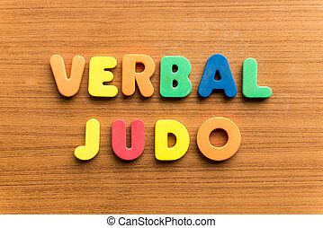 verbal judo  colorful word on the wooden background