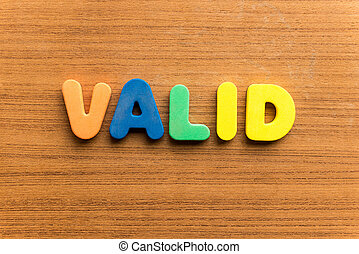 valid colorful word on the wooden background