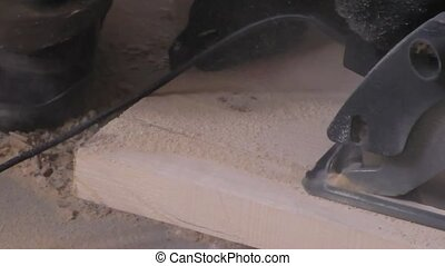 Man sawing wood Board saw , carpentry