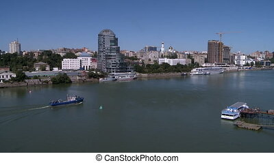 View of navigable river in city at sunny weather - Urban...