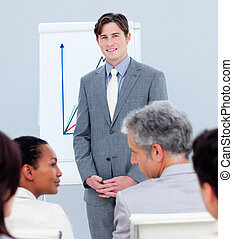 Confident businessman doing a presentation