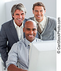 Concentrated business partners working at a computer together