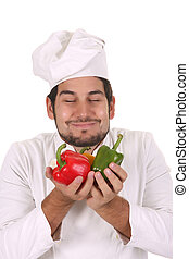 chef smelling the aroma of peppers