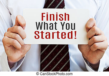 Finish What You Started. Card in male hands