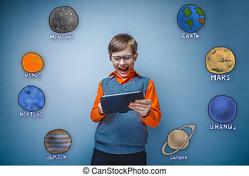 Teen boy with glasses grins and runs on a gray plate planets...