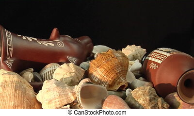 antique vessels and sea shells - loop rotation of rhyton and...