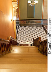 Stairs leading down to tiles diamond pattern floor in French...