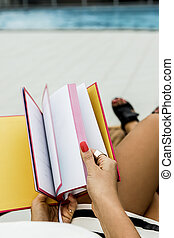 Person turning pages of a book - Image of a stylish girls...