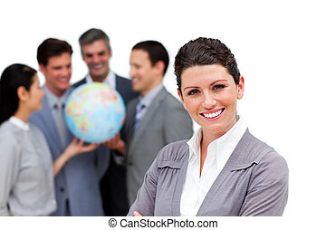 Successful business team holding a terrestrial globe against...