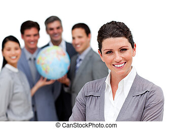 Ambitious business team holding a terrestrial globe against...