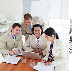 Cheerful business team having a brainstorming in a company