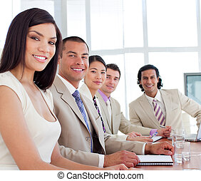 Positive business people having a meeting in a company