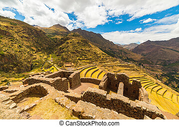 Inca terraces and building ruins in Pisac, Sacred Valley,...