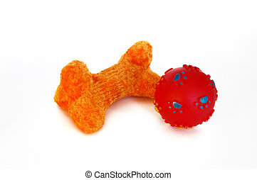 Orange Dog Bone Toy and Red Ball Isolated On White.