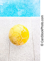 old yellow ball