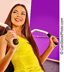 Girl workout on simulator in sport gym - Happy girl workout...