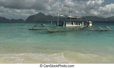 Traditional Philippines boat at tropical island - Tropical...