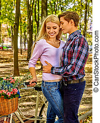 Couple with retro bike in the park - Yuong couple with retro...