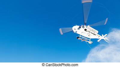 Heli Skiing Helicopter takes-off from a ski slope, in...