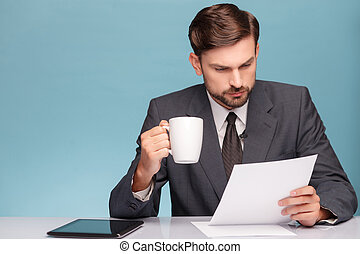Attractive male newscaster with cup of tea - Handsome young...