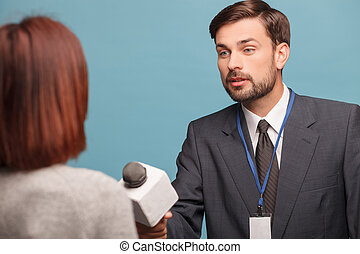 Attractive young journalist is interviewing the lady -...