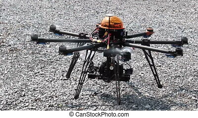 RC Helicopter was landing on a gravel surface