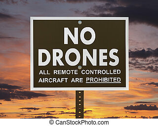 No Drones Sign with Sunset Sky