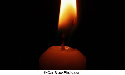 Candle lights - Human hand lights a candle using a lighter...