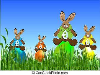 Eastern eggs  on the grass  with three rabbits
