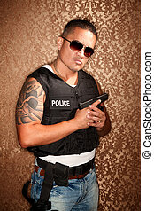 Hispanic Cop Holding Gun - Hispanic Cop Wearing Bulletproof...