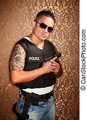 Hispanic Cop Holding Gun - Hispanic Cop Wearing Bulletproof...
