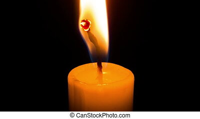 A candle burns timelapse. - Close up shot of yellow or white...