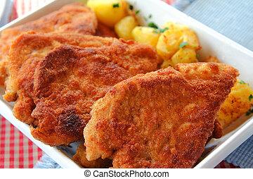 Wiener Schnitzel, Austrian dish - Crispy golden brown color...