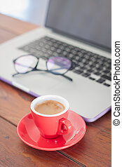 Red coffee cup on work station, stock photo