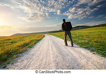 Person on the road - Person walk on the road lane. Traveling...